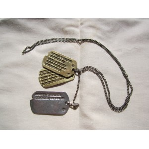 Dogtag set with two brass and one silver